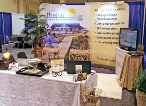 TheInnkeeper.com's trade show booth at the 2014 PAII conference. Mariah and her team added homey finishing touches such as the plants!