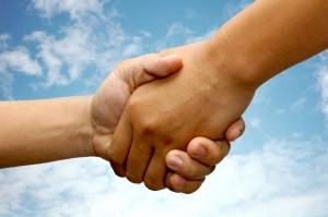 Handshake Demonstrating Transfer of Inn, B&B, or Dude Ranch Ownership