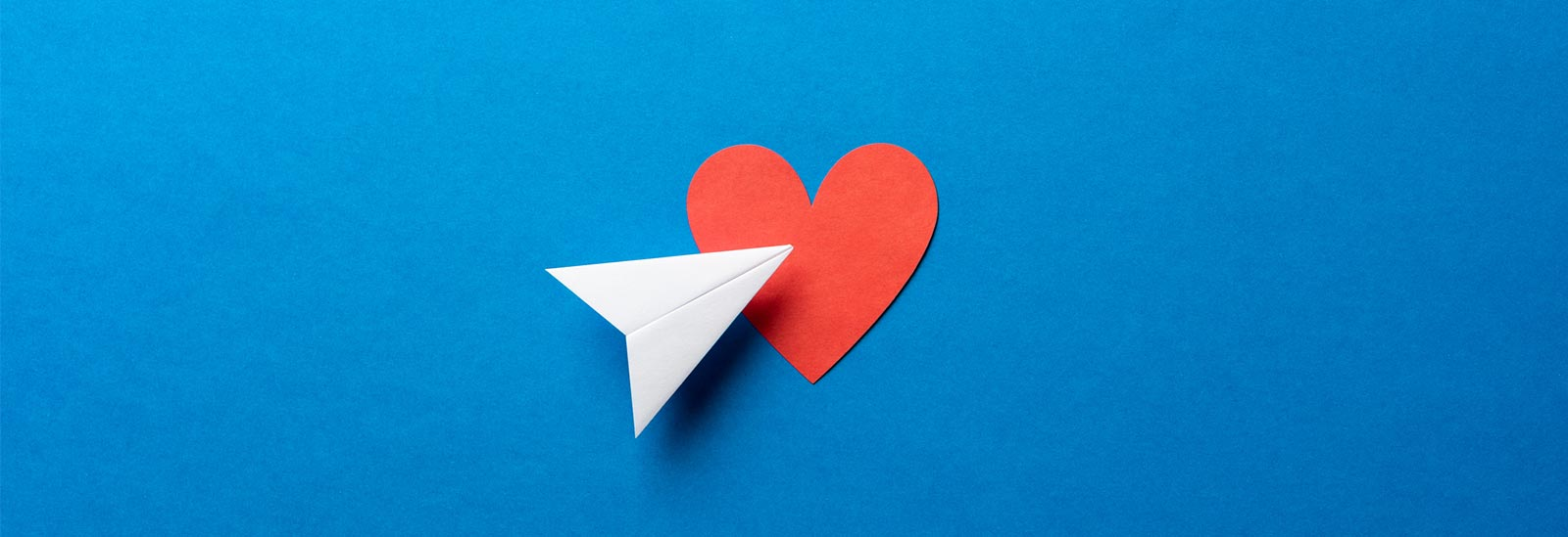 Paper Airplane and Heart Because you can email us!