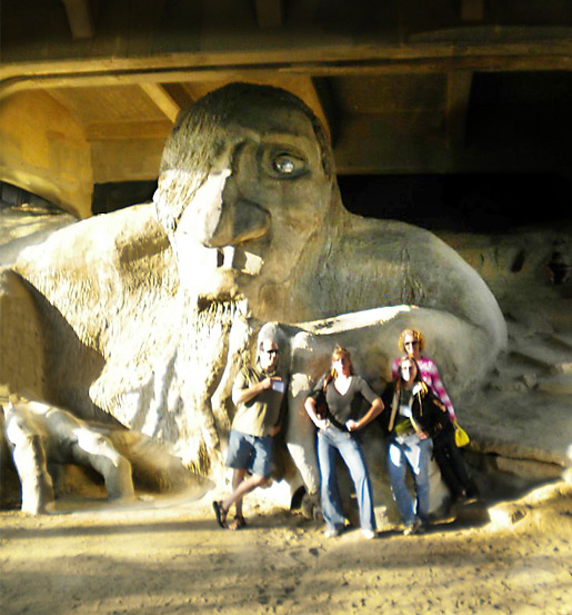 Corey Edwards, Katie Pate, Kailey Lampert & Laura Alisanne posing with the Fremont Troll in Seattle